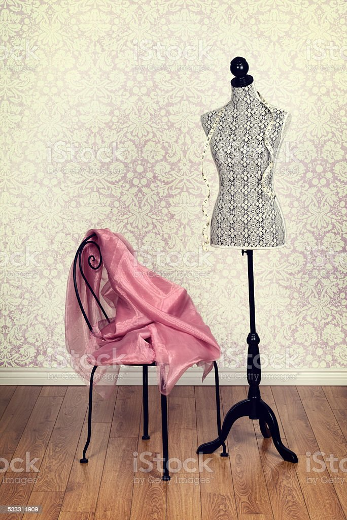vintage dress form pink fabric stock photo