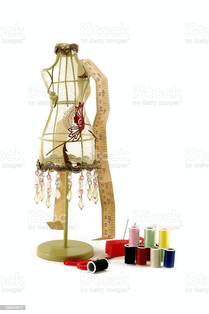 Vintage dress model and sewing equipment stock photo