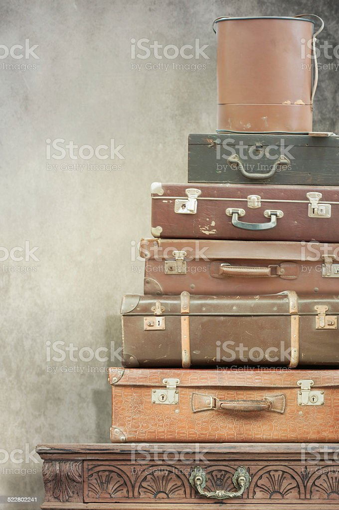 Vintage dresser with suitcase stock photo