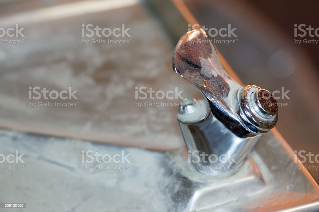 Vintage drinking fountain - non working- covered in dust stock photo