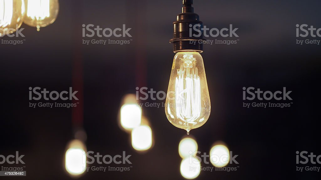 Vintage Edison Light Bulbs with closer one focused stock photo