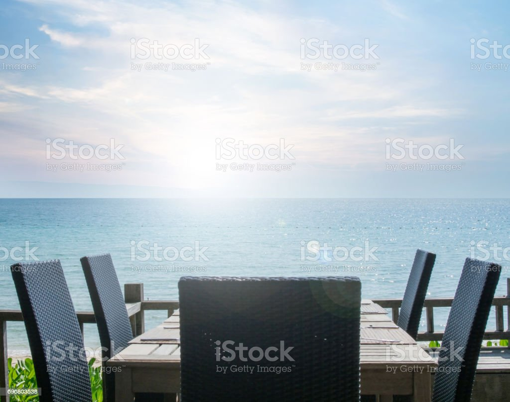 Vintage effected on table setting at beach restaurant, with sea view stock photo