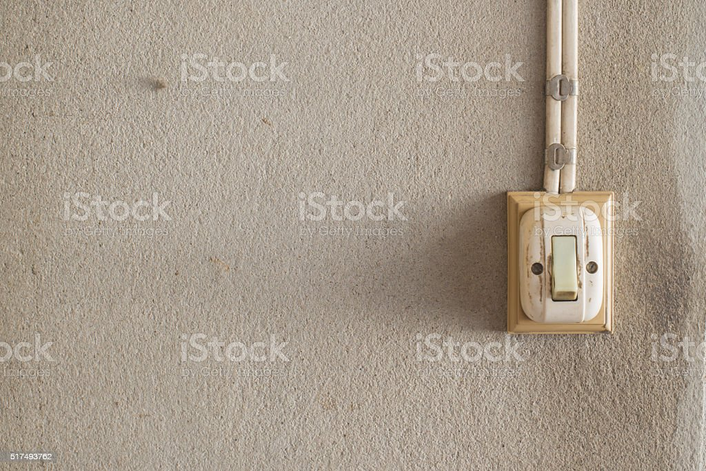 vintage electric switch on the old wall stock photo