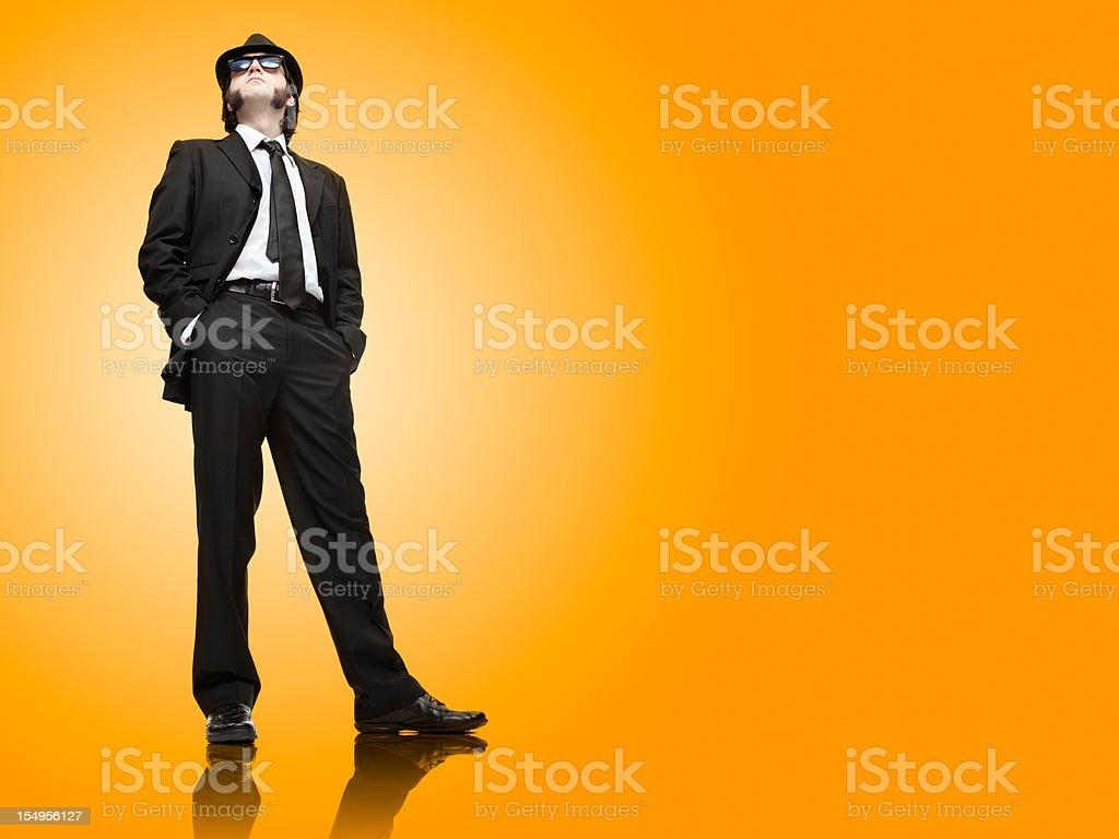 vintage elegant business leader man  on orange and copyspace royalty-free stock photo