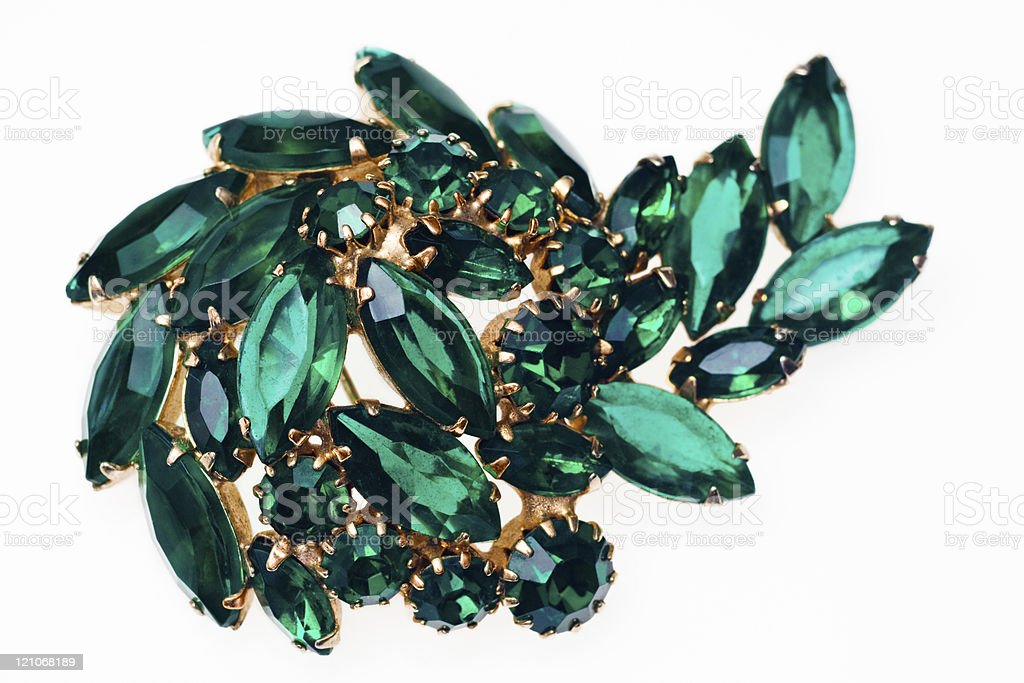 Vintage emerald green brooch isolated on a white background royalty-free stock photo