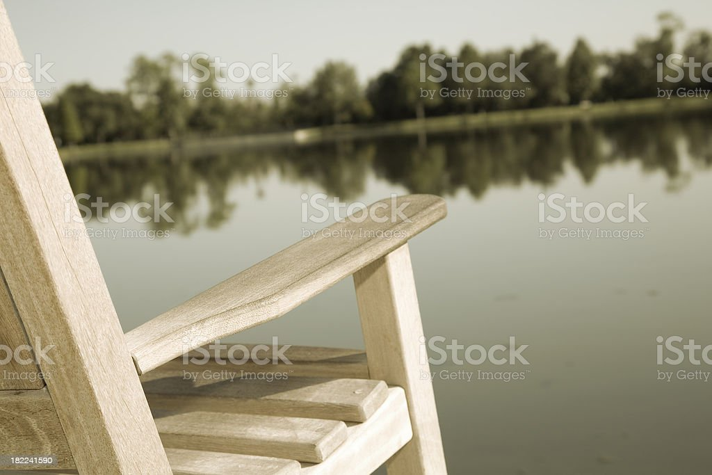 Vintage Empty Chair Looking Over a Lake royalty-free stock photo