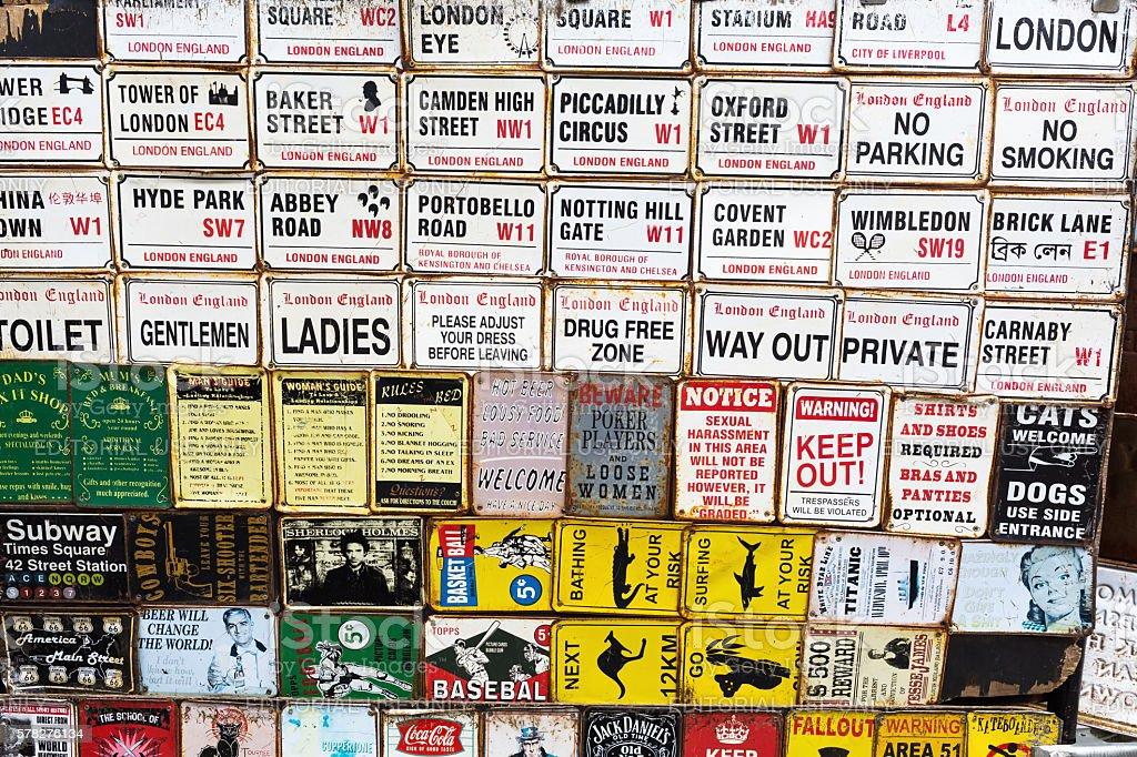 vintage enamel signs at the Portobello Road in London stock photo