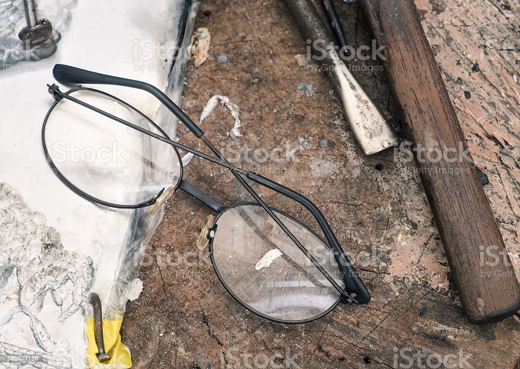 Vintage eyeglasses with set of hand tools stock photo