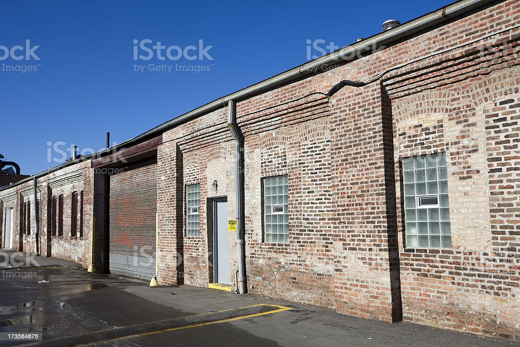 Vintage factory with roll up door  in Chicago stock photo