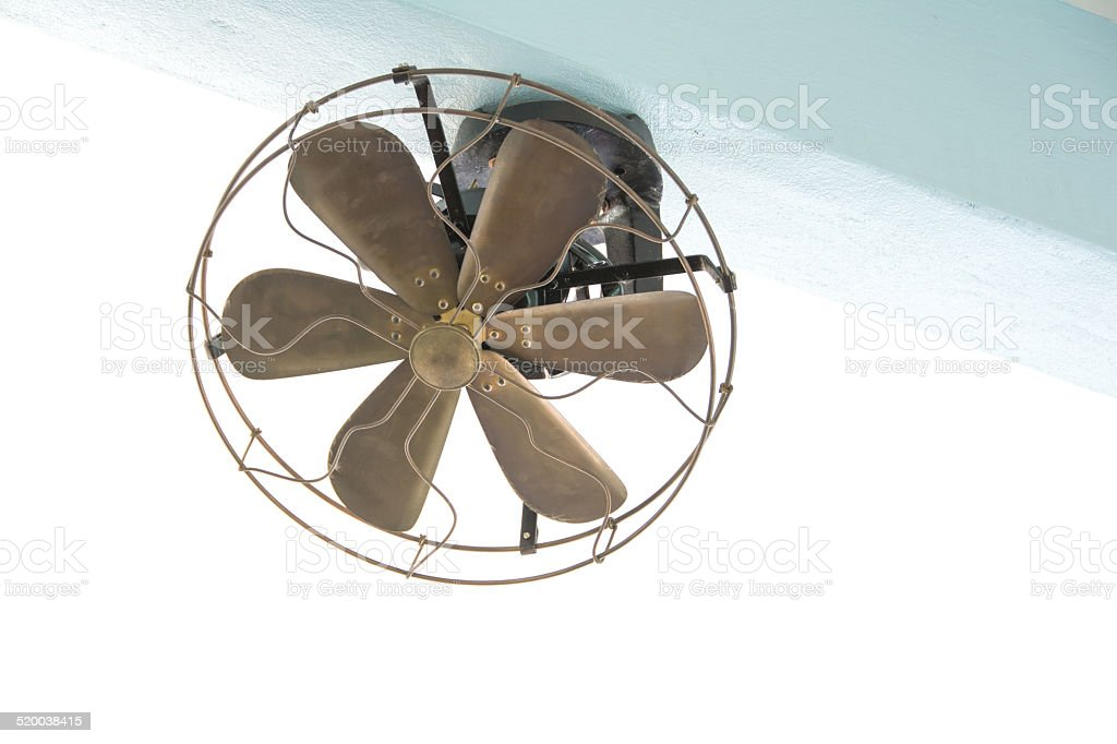 vintage fan hang on a wall stock photo
