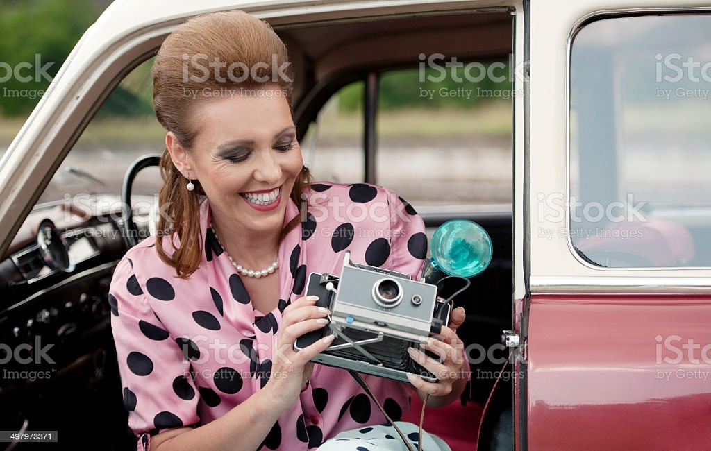 Vintage Female Photographer Portret in an Old Car stock photo