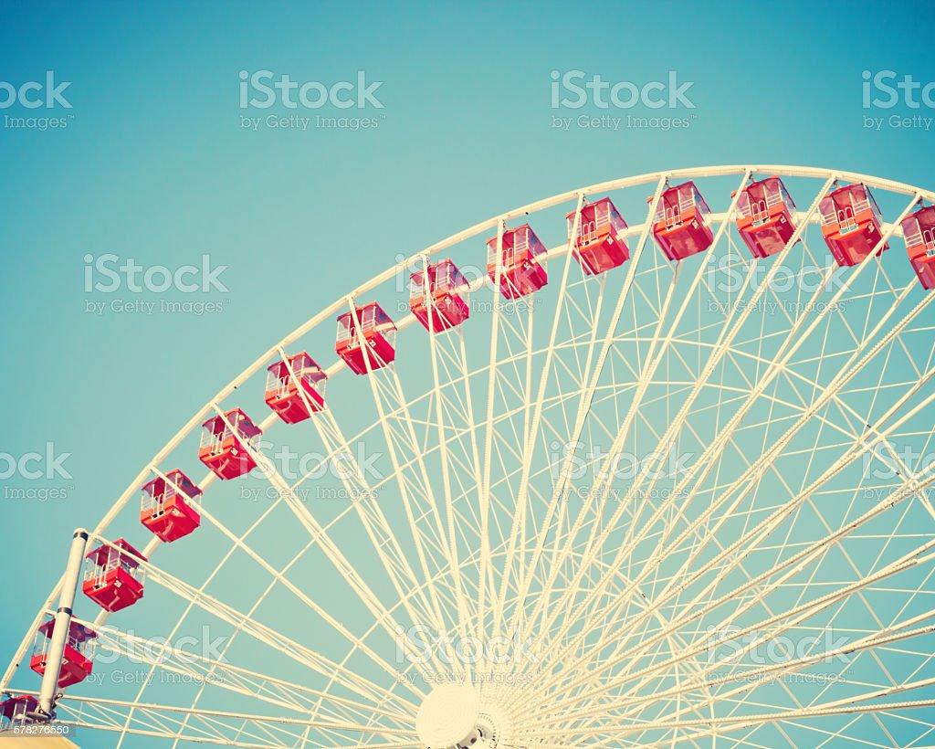 Vintage ferris wheel on blue sky stock photo