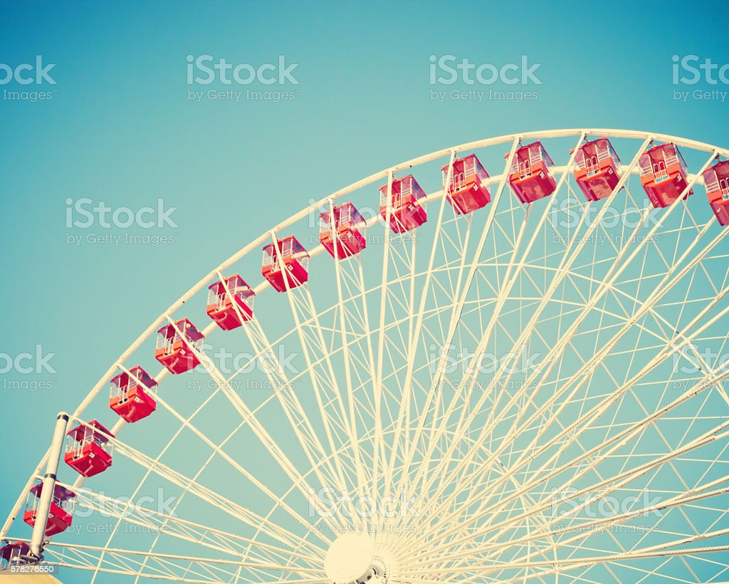 Vintage ferris wheel on blue sky stock photo