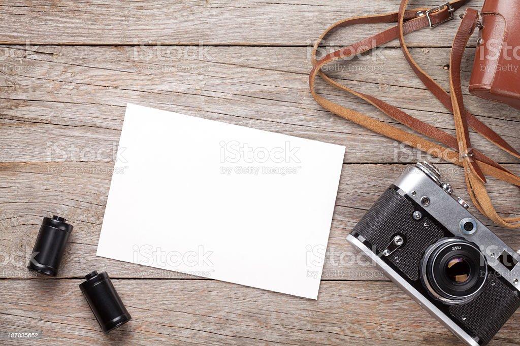 Vintage film camera and blank photo frame stock photo