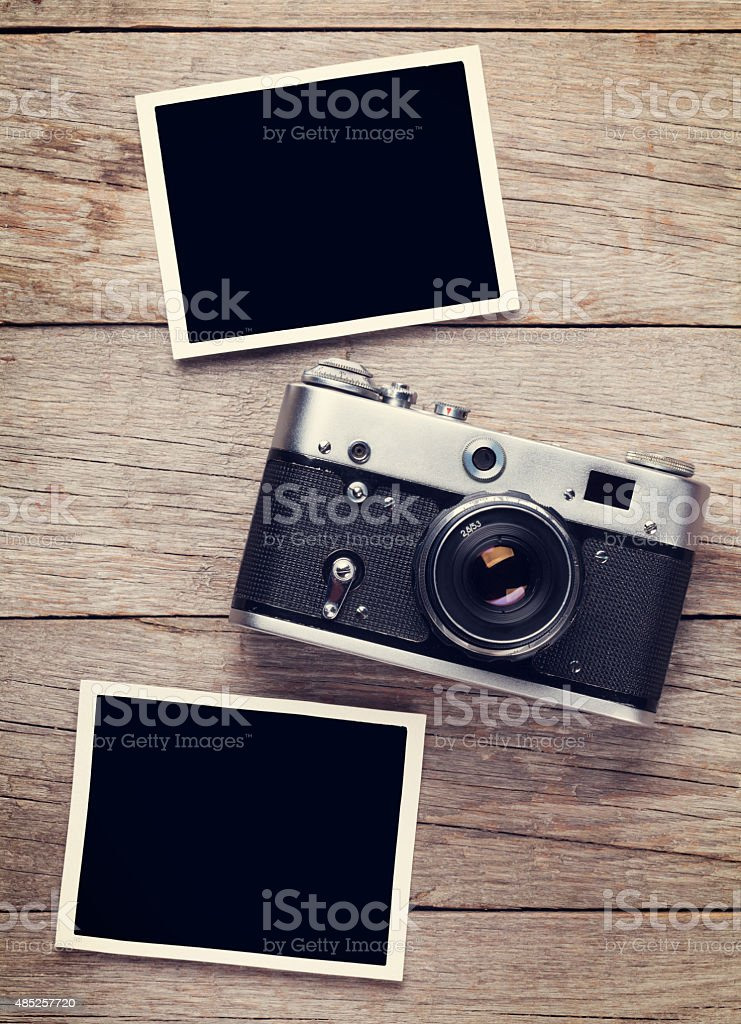 Vintage film camera and two blank photo frames stock photo