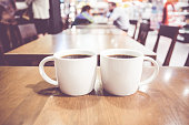 Vintage filter, couple of White coffee cup on wood table