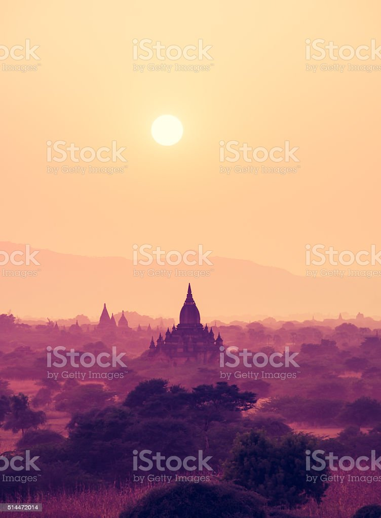 vintage filter : Silhouette Sunset scene with Pagoda field stock photo