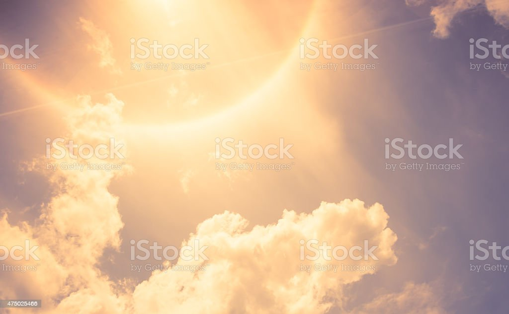 Vintage filter : Sun Halo with cloud and blue sky stock photo