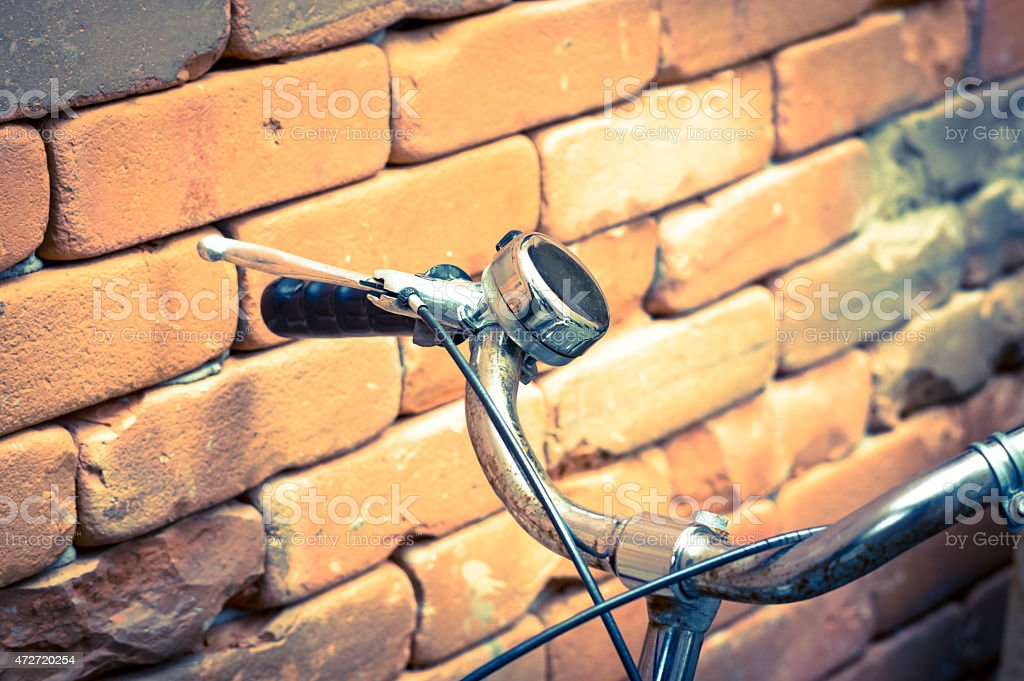 Vintage filtered of Bicycle Handlebar with bricks wall. stock photo