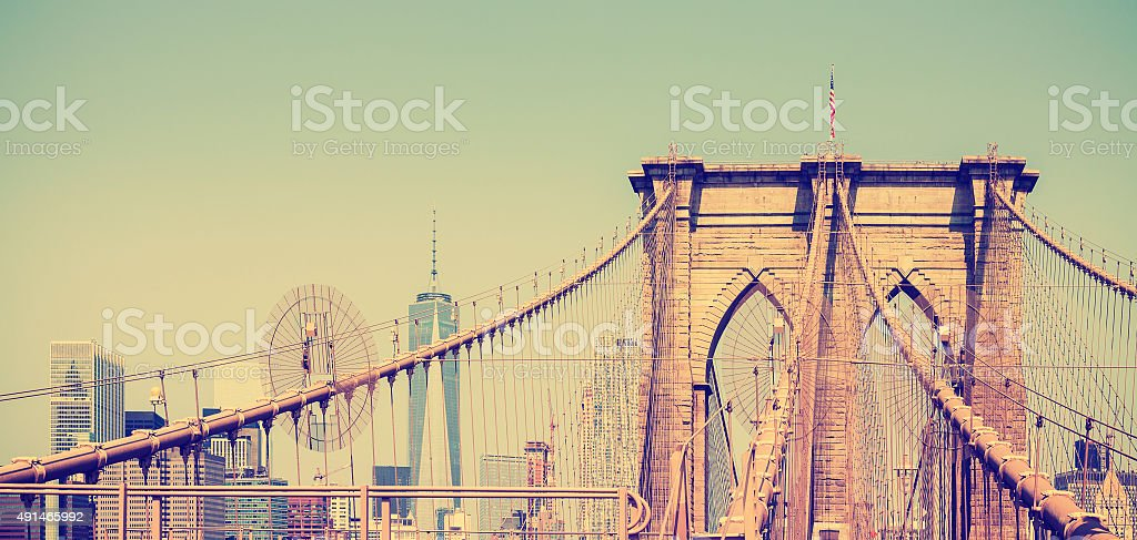 Vintage filtered panoramic picture of Brooklyn Bridge, NYC, USA stock photo
