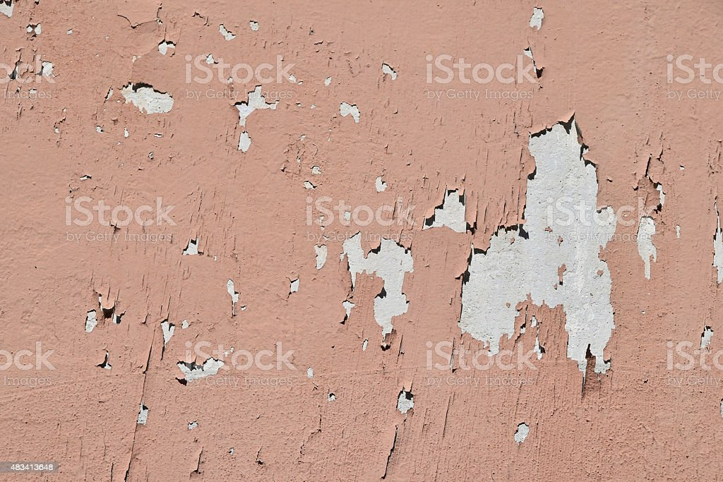 Vintage flakes of old pink paint over grey concrete wall royalty-free stock photo