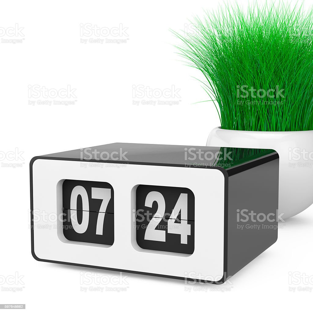 Vintage Flip Clock with Grass in White Ceramics Planter. stock photo