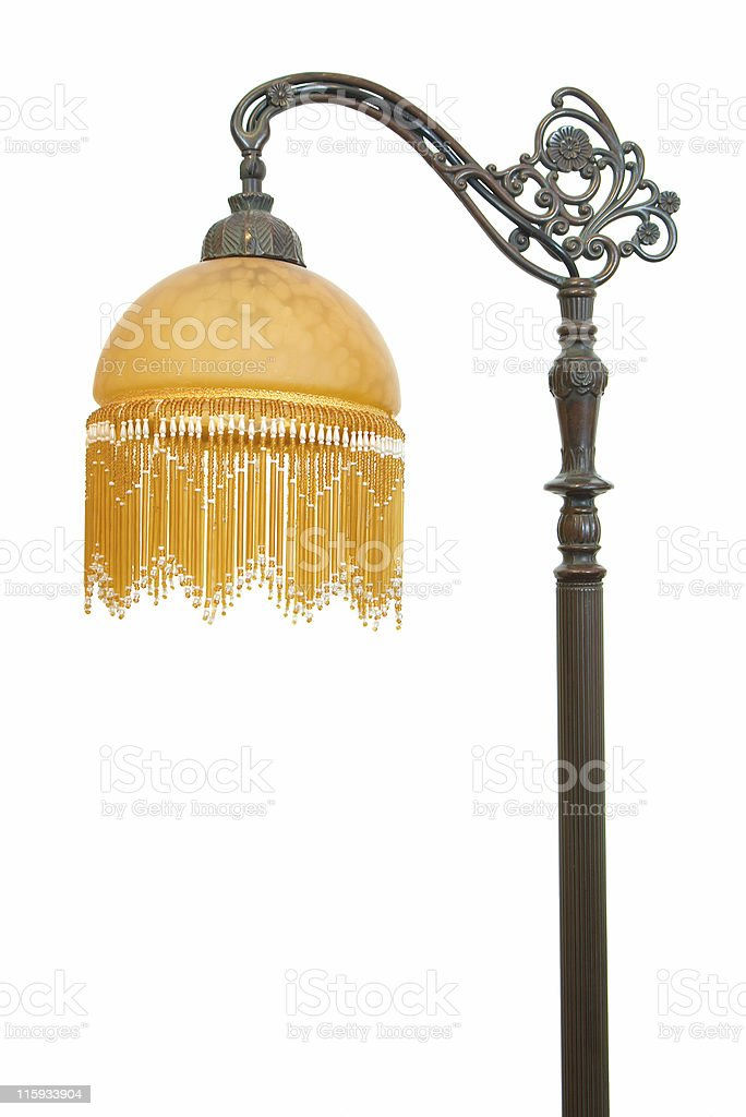 Vintage floor lamp with wrought iron stand and yellow shade stock photo