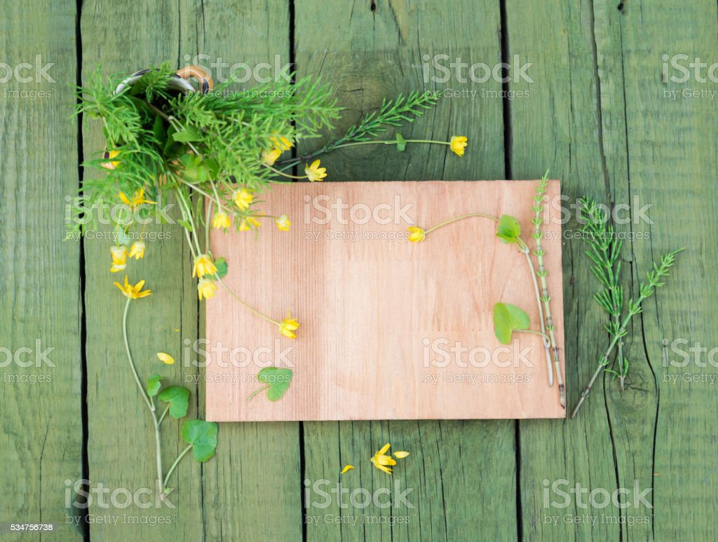 Vintage floral background. Wooden plank and yellow wildflowers. Copy space stock photo