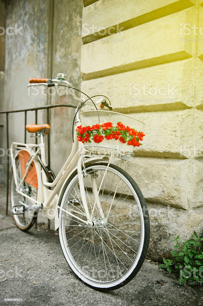 Vintage Flowered bike in Italy sunny day stock photo