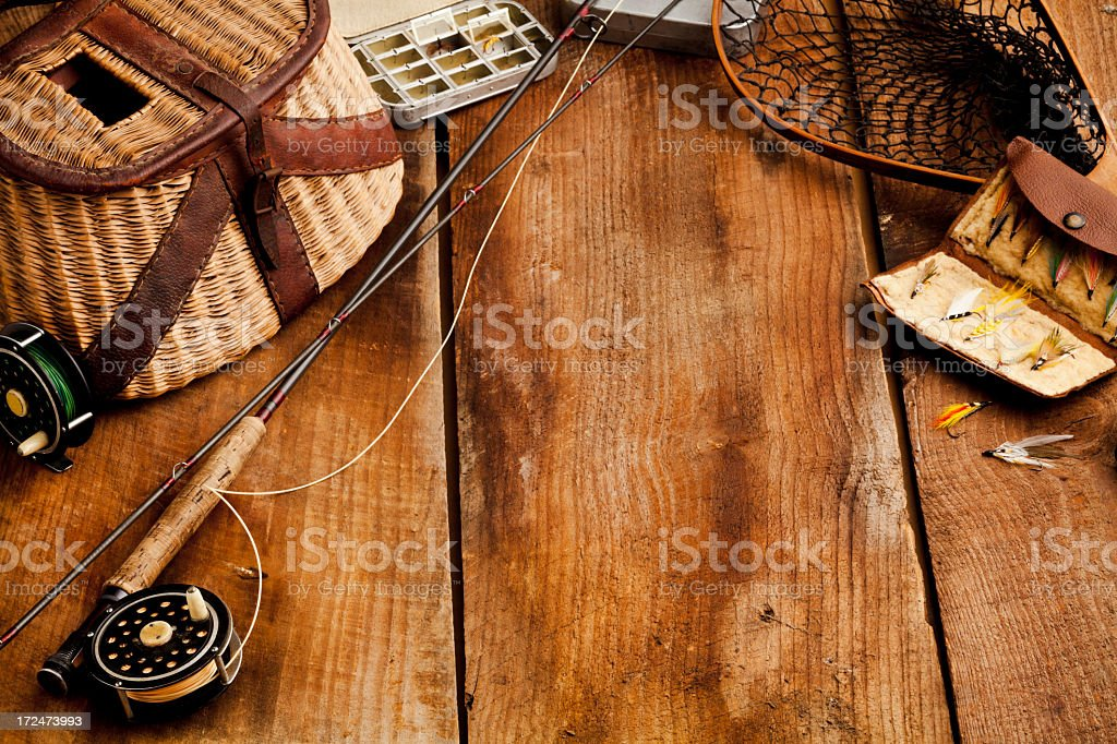 Vintage Fly-Fishing Equipment; Rod, Flies, Creel. XXXL royalty-free stock photo