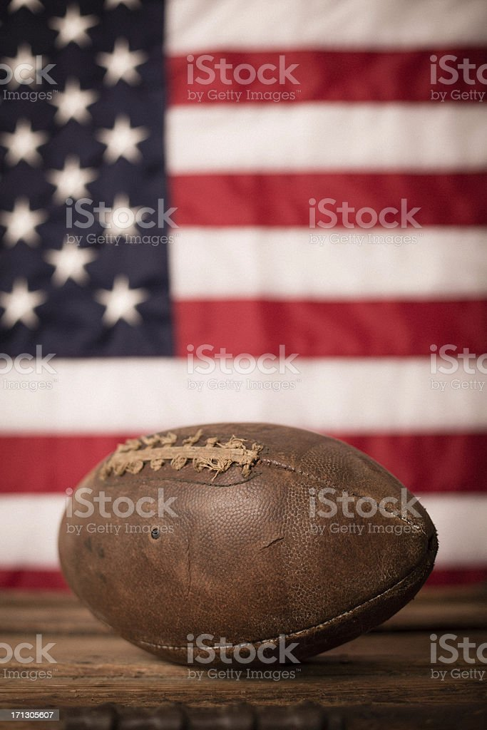 Vintage Football in Front of American Flag royalty-free stock photo