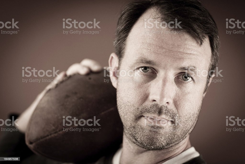 Vintage Football Player Holding Ball Over His Shoulder royalty-free stock photo