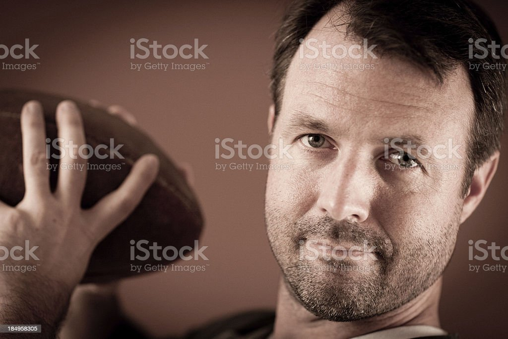 Vintage Football Player Preparing to Throw a Pass royalty-free stock photo