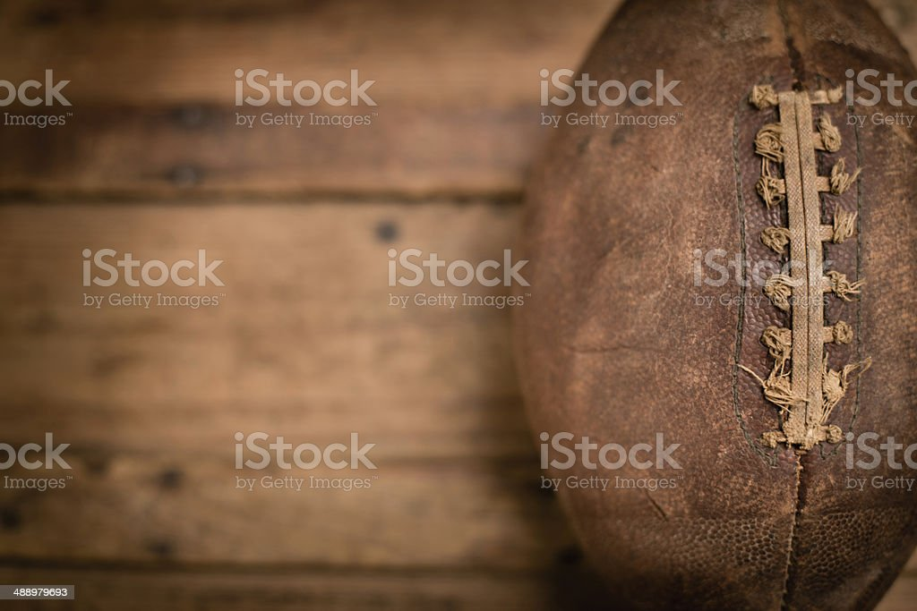 Vintage Football Sitting on Old Wood Trunk, With Copy Space stock photo
