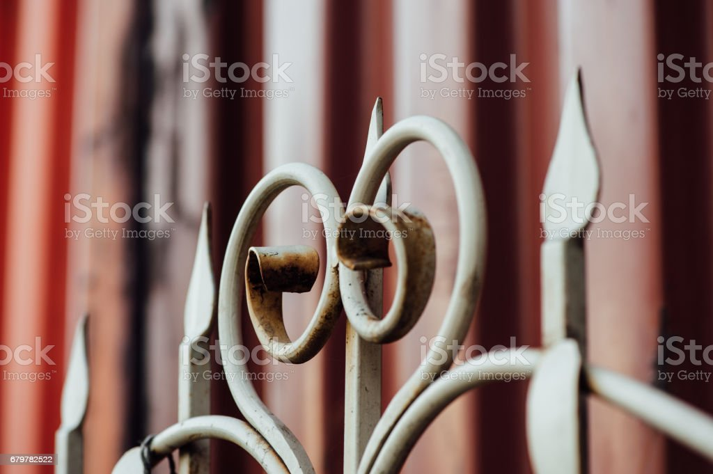 Vintage forged fence stock photo