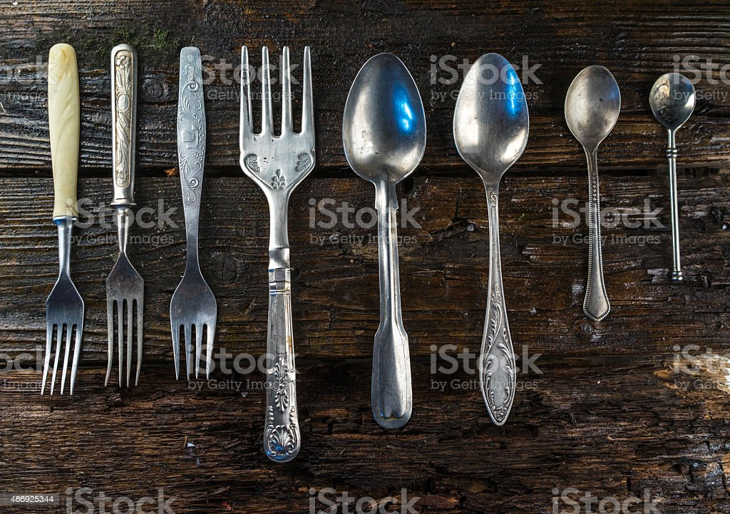 Vintage fork and spoon on the old kitchen table stock photo