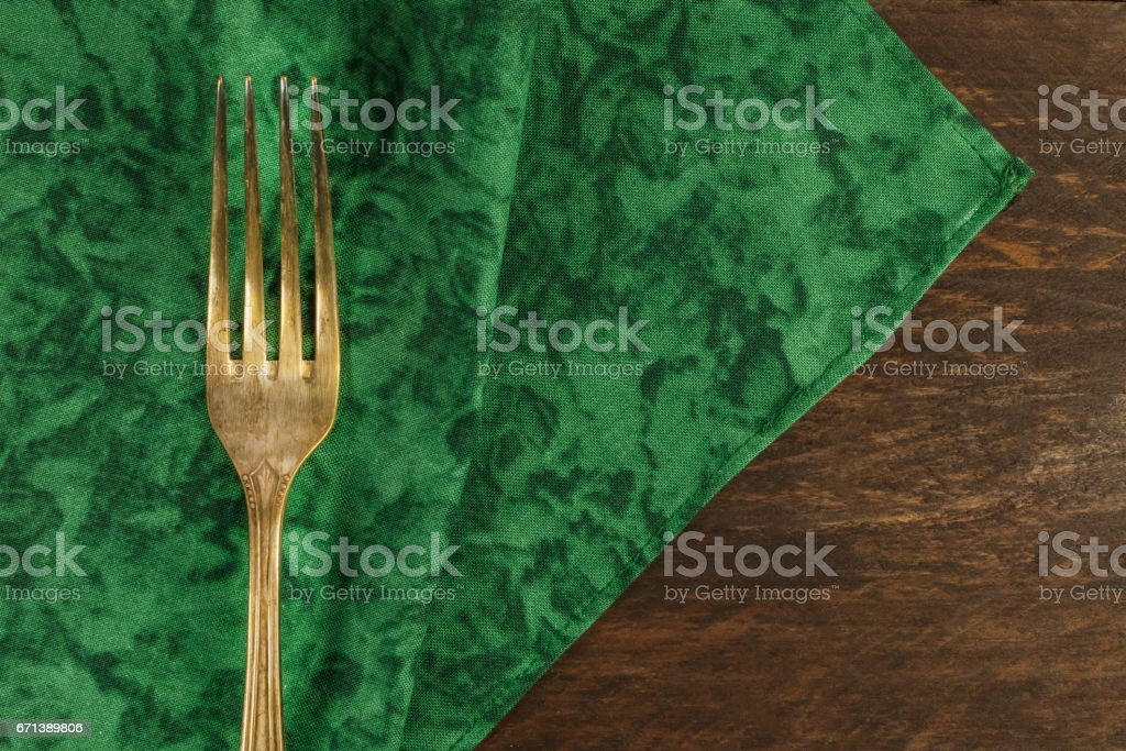 Vintage fork and wine cork on dark wooden background stock photo