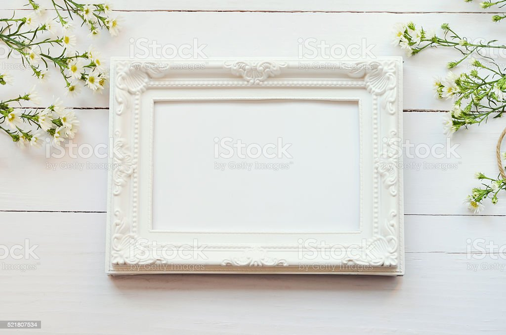 Vintage frame on white wooden background stock photo