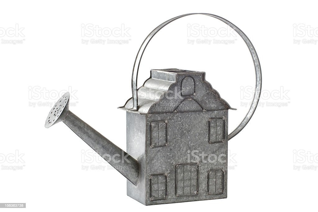 Vintage galvanized watering can shaped like a house royalty-free stock photo