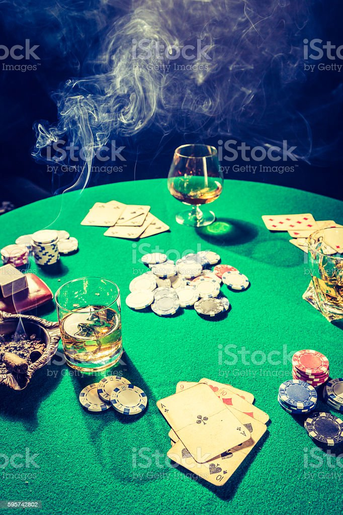 Vintage gambling table with chips and cards stock photo