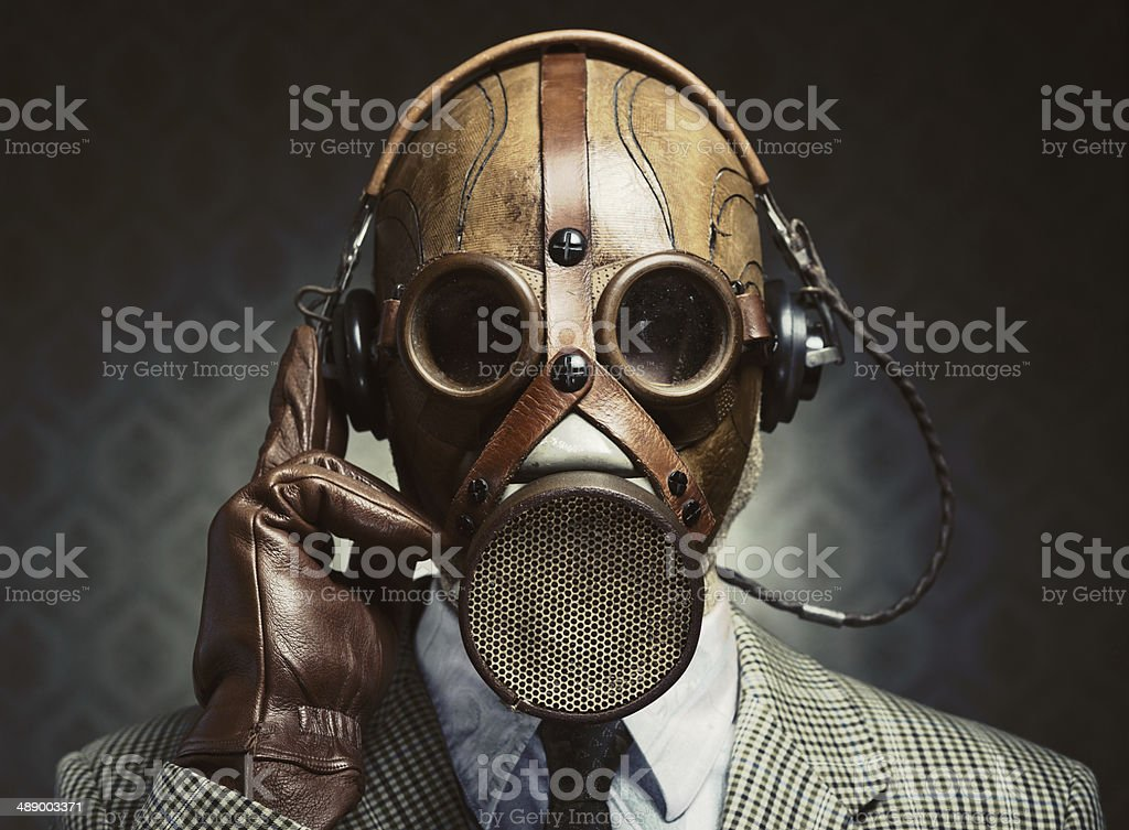 Vintage gas mask and headphones stock photo