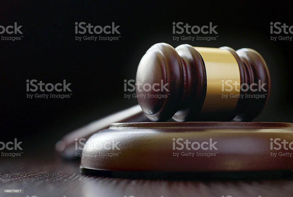 Vintage gavel placed on a round sound block stock photo