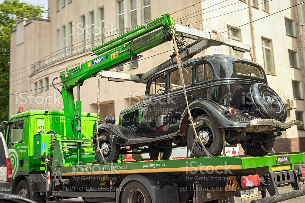 vintage german motor car Horch 853 on the tow truck stock photo