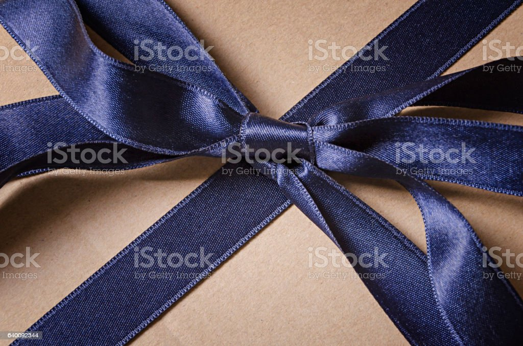 Vintage gift box with blue ribbon bow detail, top view stock photo