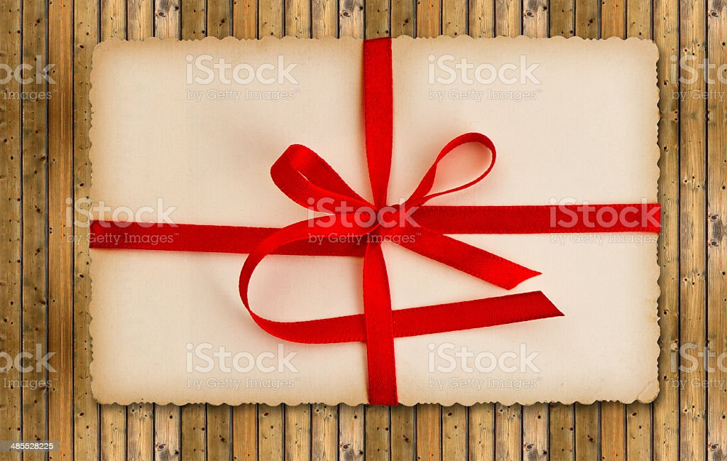 vintage gift card with red ribbon stock photo