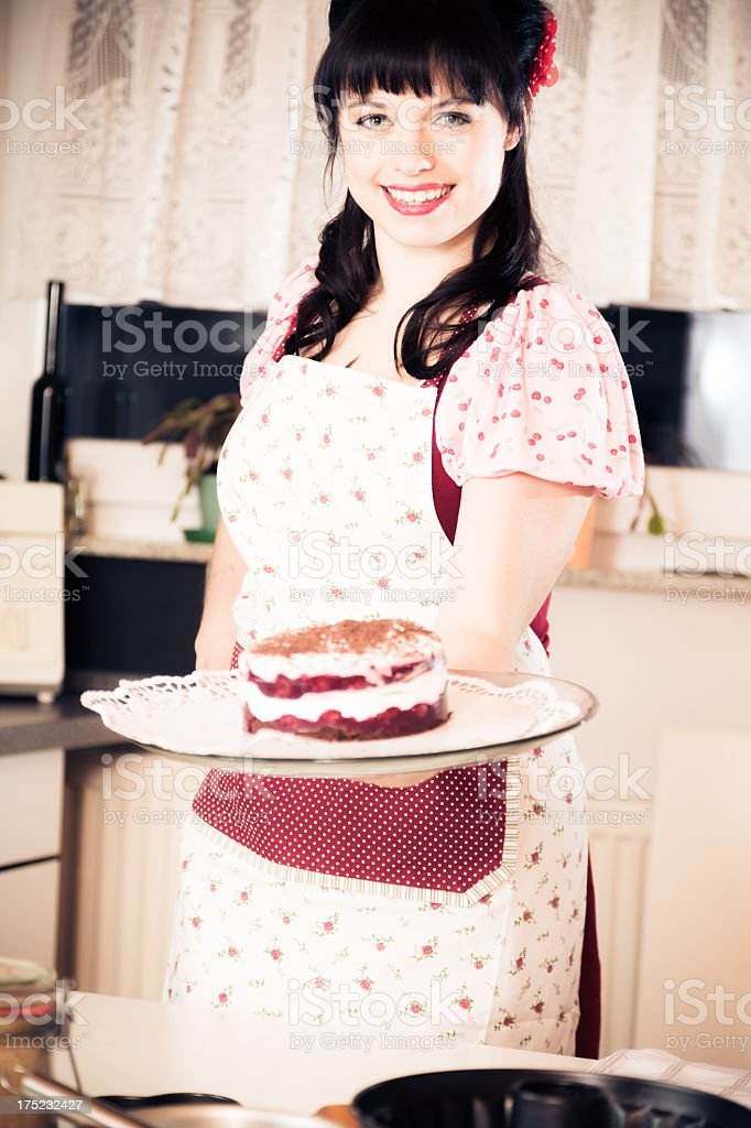 vintage girl baking a cake royalty-free stock photo