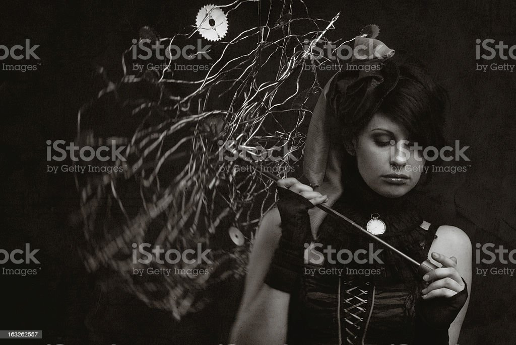 Vintage girl with umbrella of branches and gears royalty-free stock photo