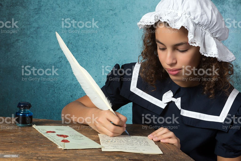 Vintage girl writing a letter stock photo