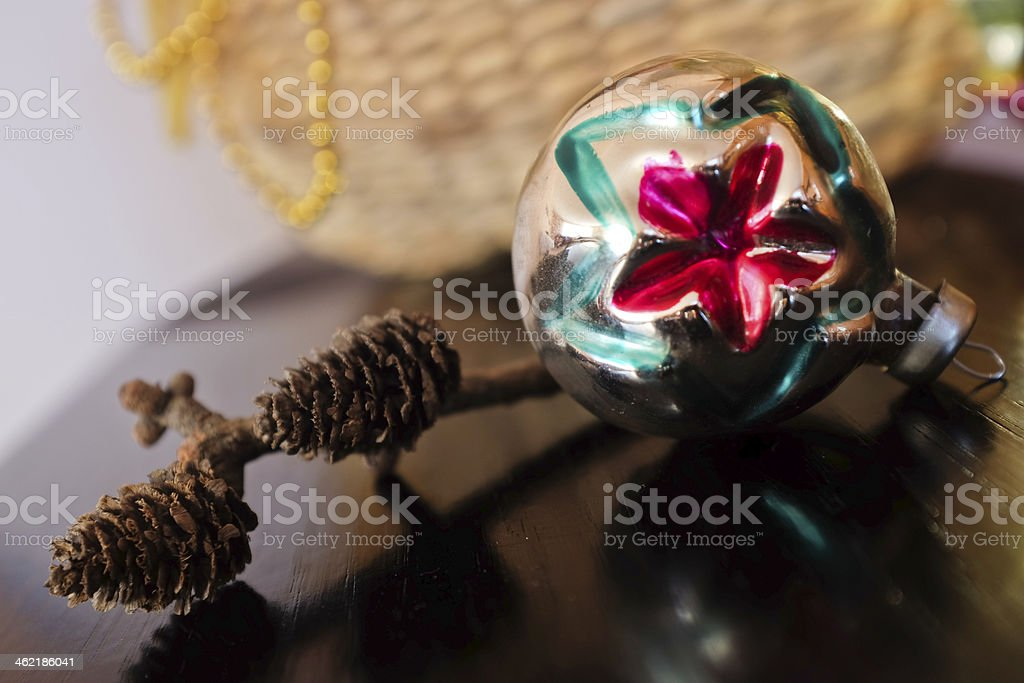 Vintage glass bauble and pine cones stock photo