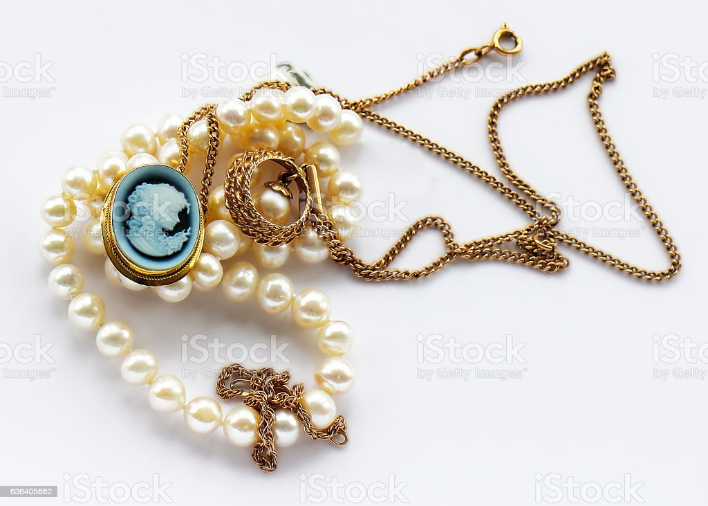 Vintage  gold jewelry brooch and white pearl stock photo